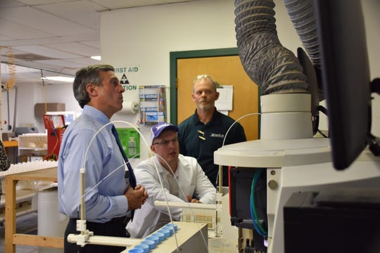 Gov. John Carney tours Agro-Lab, a Harrington-based agricultural technology company.