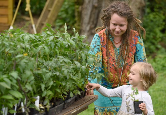 In a May 18, 2019 photo, Paige Barocca, of Glendale, and her daughter Clementine, 4, shop at Moon Valley Farm's plant sale in Cockeysville, Md.