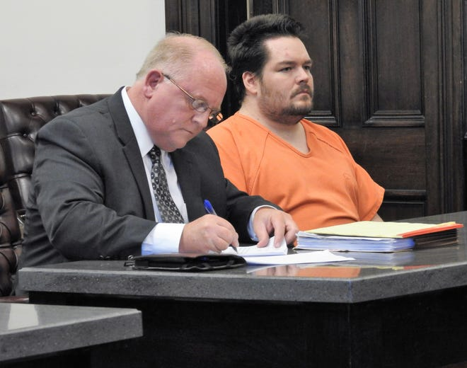 Public Defender Jeffrey Mullen with client Jeffrey D. Ellis Monday in Coshocton County Common Pleas Court. Ellis changed his pleas from not guilty to guilty, via an Alford plea, to all charges in a 41-count indictment relating to 31 counts of rape of juveniles and 10 counts of using a minor in nudity-oriented materials.