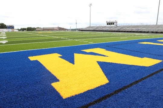 The new turf at West Muskingum's stadium is nearing completion. With WM at center field, the western end zone features WEST M, while Tornadoes adorns the east end zone.