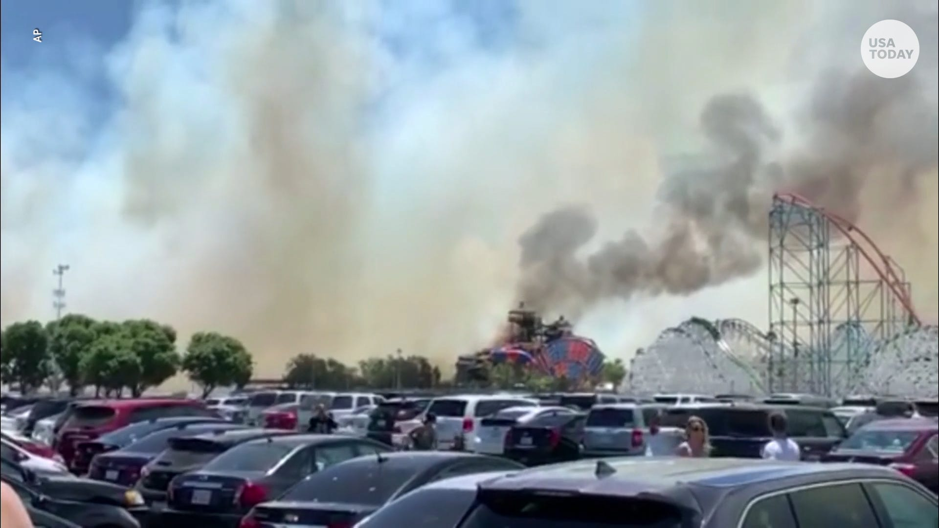 Fast-moving fire shuts down Six Flags park, sparks panic