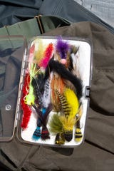 "Fly fishing guru Tom Rosenbauer advises bass fly anglers to travel light:  ""Carry a fly box you can stick in your pocket."""