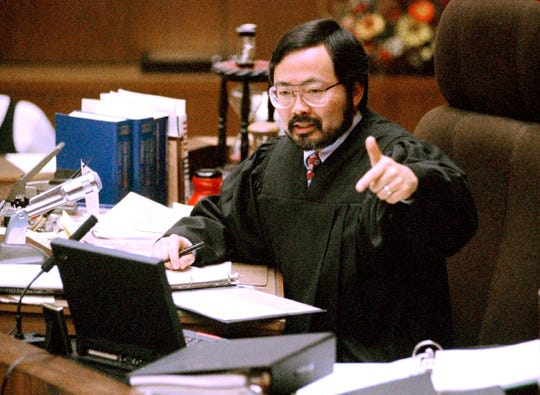 In this Feb. 12, 1995, file photo, Judge Lance Ito gives instructions to the jury before all parties in the O.J. Simpson double murder trial depart on a tour of four prominent Brentwood sites in Los Angeles.