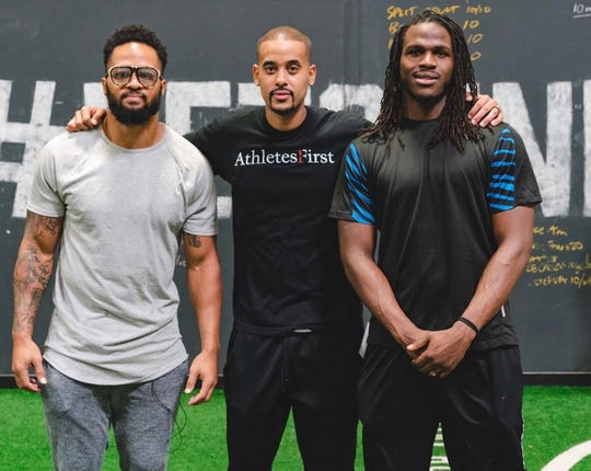 Ravens safety Earl Thomas, agent David Mulugheta and Jamaal Charles, recently retired running back.