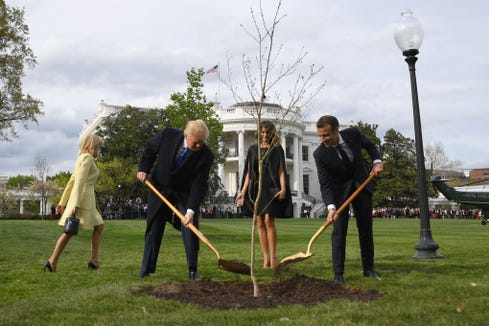 US President Donald Trump and First Lady Melania Trump participate in a tree planting ceremony with French President Emmanuel Macron and his wife Brigitte Macron on the South Lawn of the White House in Washington, DC, on April 23, 2018.
