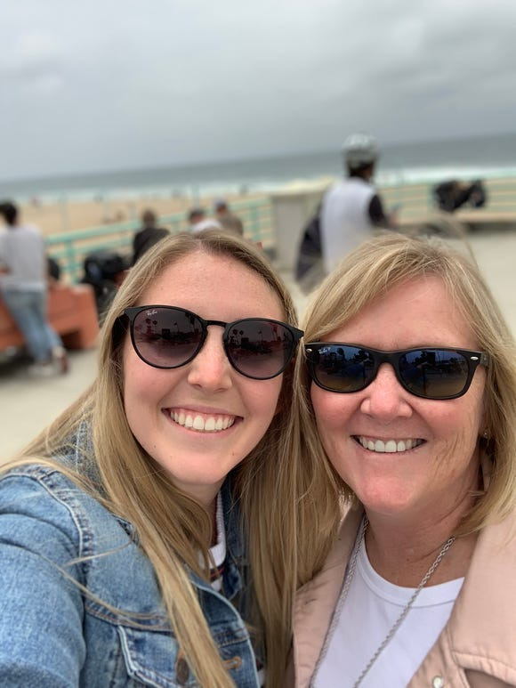 Camille and Ann Andersen pose for selfies on the Manhattan Beach Pier