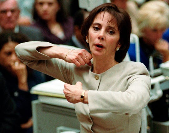 In this Sept. 26, 1995, file photo, prosecutor Marcia Clark demonstrates to the jury how the murders of Nicole Brown Simpson and Ron Goldman were committed during her closing arguments in the O.J. Simpson double-murder trial in Los Angeles.