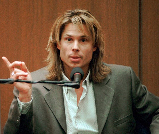 "In this March 21, 1995, file photo, Brian ""Kato"" Kaelin testifies under direct examination during the O.J. Simpson double-murder trial in Los Angeles."