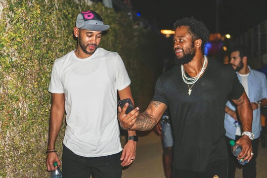 David Mulugheta (left) helped safety Earl Thomas land a four-year, $55 million contract from the Ravens this offseason.
