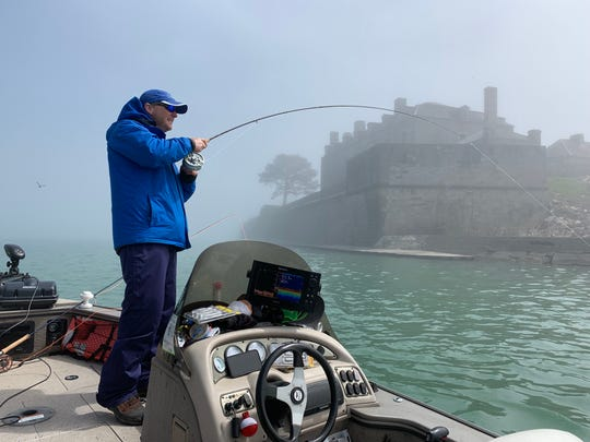 In the shadow of Ft. Niagara State Park, Capt. Frank Campbell battles a smallmouth bass that took a Clouser fly in about 12 feet of water.