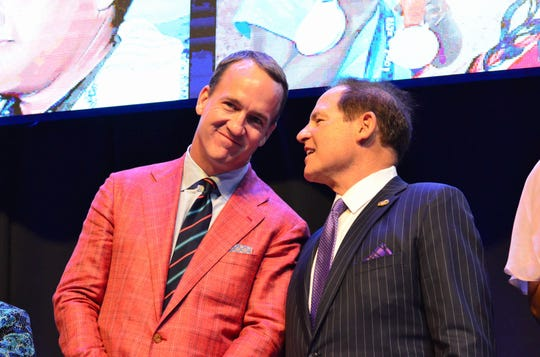 Les Miles speaks to Peyton Manning at the Louisiana Sports Hall of Fame induction ceremony in Natchitoches on Saturday.