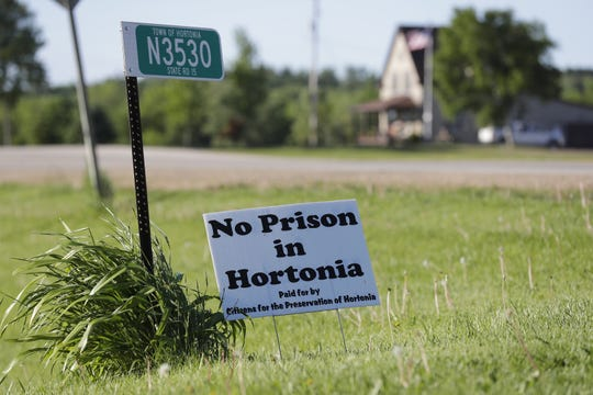 Russ and Marcia Oberstadt along with their daughter Kayla Oberstadt oppose a new youth prison that would be located near the edge of their property. A sign showing opposition is at the entrance to their home Monday, June 10, 2019, in the Town of Hortonia, Wis. According to Russ Oberstadt it would be located about 150 feet from their property. Kayla Oberstadt now lives in Columbus, Ohio.