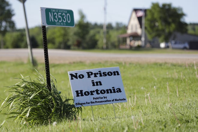 """No Prison in Hortonia"" signs were scattered across the town of just over 1,000 residents after Gov. Tony Evers announced Hortonia as one of the proposed locations for a youth prison."