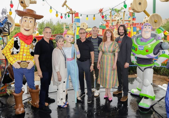 """""""Toy Story 4"""" stars Tom Hanks, from left, Annie Potts, Tim Allen, Tony Hale, Christina Hendricks and Keanu Reeves visit Toy Story Land at Disney's Hollywood Studios on June 8 in Orlando, Florida."""