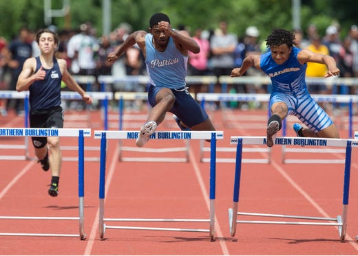 NJSIAA Track and Field Meet of Champions takes place at Northern Burlington High School.  Freeholds Felix Lawrence , center, takes second as North Brunswick's Rami Berberena wins the 400 hurdles event.Columbus, NJSaturday, June 08, 2019