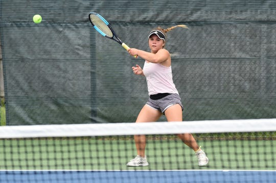 Kaitlyn Strain, of Abilene, hits a shot during the third round of the Texas Slam Girls 16 singles consolation bracket at Clack Middle School on Tuesday. Strain battled, but fell 6-4, 6-2 to end her tournament.