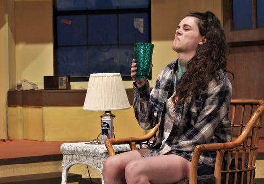 "Libby (Lauren Bridwell) reacts to her first taste of California tap water in this rehearsal scene for McMurry University's summer theater production of Neil Simon's ""I Ought to be in Pictures."""