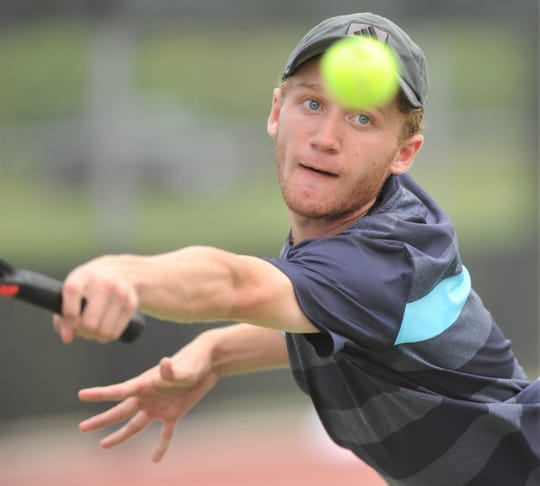 Abilene Christian High's Ryan Flanagan stretches to hit a shot during his Texas Slam consolation match with Amarillo's Jackson Harwell. Harwell won the match 4-6, 6-3, 10-7 Tuesday, June 11, 2019, at Craig Middle School.