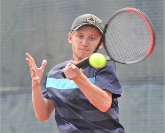 Abilene Christian High's Ryan Flanagan returns a shot against Amarillo's Jackson Harwell in a Texas Slam consolation match. Harwell won the match 4-6, 6-3, 10-7 Tuesday, June 11, 2019, at Craig Middle School.