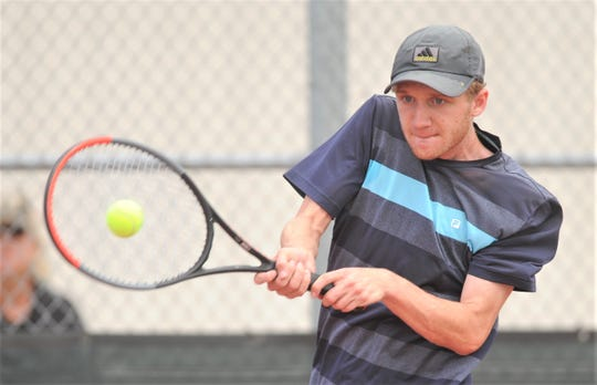 Abilene Christian High's Ryan Flanagan returns a shot during his Texas Slam consolation match against Amarillo's Jackson Harwell. Harwell won the match 4-6, 6-3, 10-7 Tuesday, June 11, 2019, at Craig Middle School.