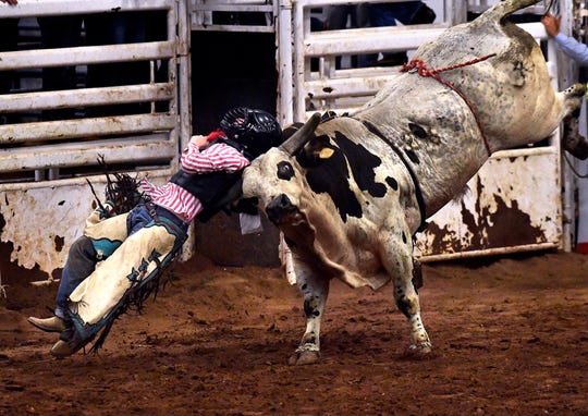 "Michael ""Tripp"" Davis of Richards is bucked off a bull Tuesday at the Texas High School Rodeo Association State Finals at the Taylor County Coliseum."