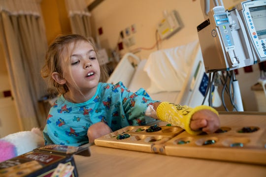 Charlie Buckley, 8, plays Mancala ahead of her kidney transplant surgery at C.S. Mott Children's Hospital in Ann Arbor on May 22, 2019.