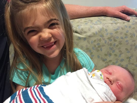 Charlie Buckley holds her newborn brother, Oliver, on June 11, 2016.