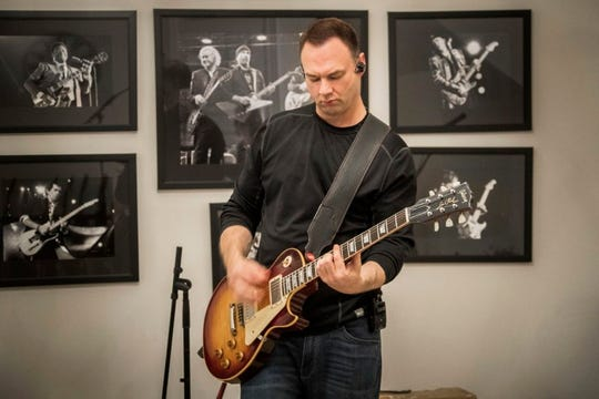 Maine-Endwell native Thomas Tull plays guitar for the Ghost Hounds.