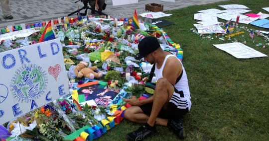 Jose Martinez looks over photos and tributes to Pulse Nightclub victims in Orlando. He lost a friend in the June 12, 2016 shooting.
