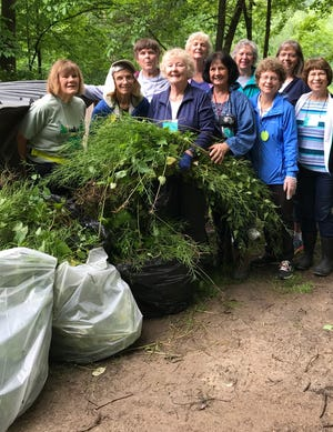 Those pictured took part in a nature study retreat June 2-7 at Mohican Outdoor School. These 10 participants harvested large bags of garlic mustard from woodland trails in an hour.