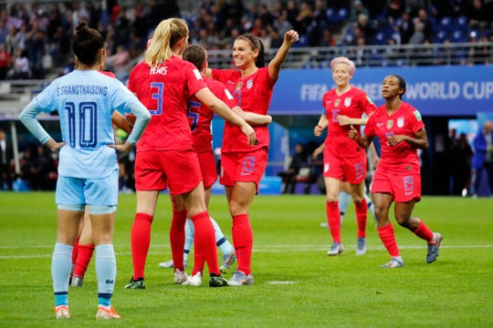 United States midfielder Sam Mewis (3) celebrates with teammates Alex Morgan (13) and Rose Lavelle (16) after scoring a goal against Thailand during the second half in group stage play during the FIFA Women's World Cup France 2019 at Stade Auguste-Delaune.