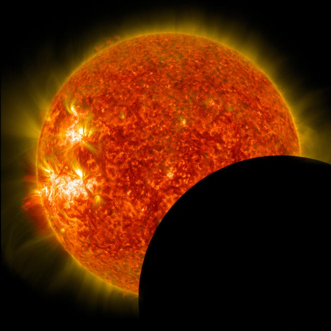 A partial solar eclipse imaged by NASA's Solar Dynamics Observatory in 2014.