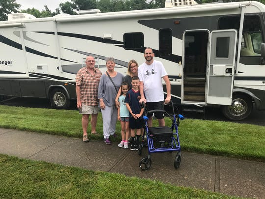 Paul and Leslie Rinderknecht of Springfield Township, right and second from right, are going on a summer vacation with their children, Leo and Nora, and Leslie's parents, Doug and Ann Spears. They have an added challenge: Paul has the progressive paralysis known as Lou Gehrig's disease.