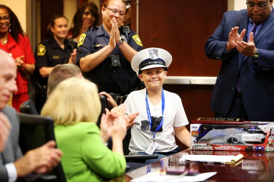 Blake Hegner, 10, of Fort Thomas, is applauded after telling the Cincinnati Police Department to take the day off during his role as 'chief for the day'. Hegner was given the opportunity to become 'chief for a day' after Christina Bold, campaign manager for the Leukemia and Lymphoma Society, bet on the activity for a fundraiser through the Matt Haverkamp Foundation. Hegner is in remission for Acute Lymphoblastic Leukemia.