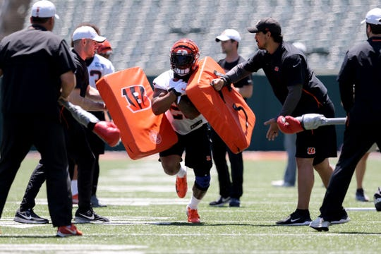 Cincinnati Bengals running back Joe Mixon (28) runs through a drill during minicamp practice, Tuesday, June 11, 2019, at Paul Brown Stadium in Cincinnati.