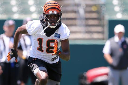 Cincinnati Bengals wide receiver A.J. Green (18) runs across the line of scrimmage during minicamp practice, Tuesday, June 11, 2019, at Paul Brown Stadium in Cincinnati.