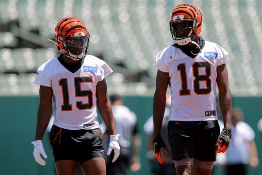 Cincinnati Bengals wide receiver John Ross (15) and Cincinnati Bengals wide receiver A.J. Green (18) work on route running during minicamp practice, Tuesday, June 11, 2019, at Paul Brown Stadium in Cincinnati.