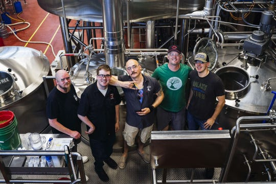 Jungle Jim's International Market workers, from left, Ferdinand Sneed and Eric Dunaway partnered with MadTree Brewing workers Sam Marts, Dan Shatto, and Ryan Johnston to prepare a limited-run beer, Everybody Gose to the Jungle, that will debut at Jungle Jim's International Craft Beer Festival in Fairfield  June 14-15.