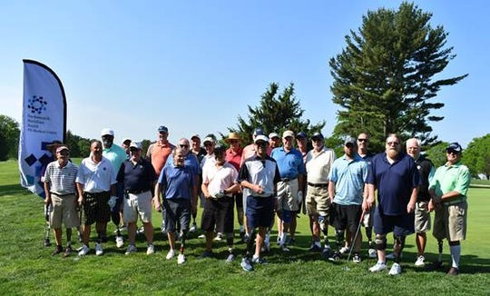 Golfers at the 20th Annual Eastern Amputee Golf Association/Howard Taylor Memorial Golf Tournament.