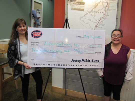 Alternatives, Inc. was grateful accepted $350 in proceeds from a Tuesday, May 7, fundraiser from Jersey Mike's of Hillsborough. Pictured are Alternatives' Vice President of Services, Fresia Skoczypec, and Alternatives' client Susan Solowsky, both of Hillsborough, who accepted the donation from Michael Hanson, Jersey Mike's Manager, on behalf of Alternatives. Funds will support one of Alternatives' many service initiatives, which include support coordination, case management, supportive counseling, life skills education, a day program, employment evaluation, training and placement, trial work experience, supported employment, and transition services.Call 908-685-1444, ext. 226 for more information or visit Alternatives' website at www.alternativesinc.org. Call Jersey Mike's of Hillsborough at 908-533-7007 for more information or visit https://www.jerseymikes.com/1060/hillsborough-njwww.