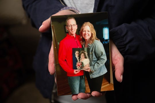 Michelle Nelson holds a photo of herself with her late husband Mike Nelsen Monday, June 10, 2019. Nelson passed away two and a half years ago and is being honored at a  NASCAR race this Fathers Day.