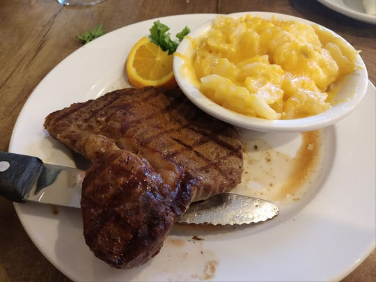 The petite top sirloin steak is pictured at Baratta's with a side of au gratin potatoes.