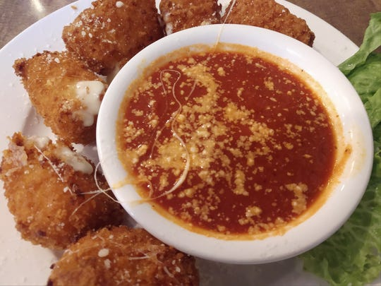Cheese sticks are served with dipping sauce at Baratta's in Des Moines.