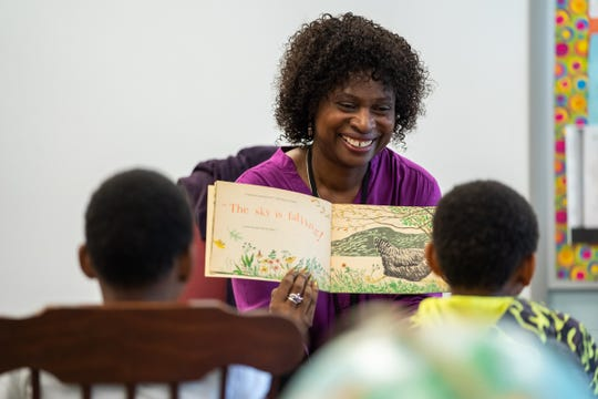 Forest Park Elementary School teacher Melinda Jackson reads to a group of second graders in the resource room at the school in Eastpointe on Monday, June 10, 2019.