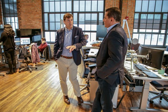 James D. Farley Jr. is the President of New Businesses, Technology & Strategy at Ford Motor Company, left, talks with Sherif S. Marakby, president and chief executive officer, Autonomous Vehicles LLC,  in their offices at The Factory at Corktown in Detroit on Tuesday, May 7, 2019.