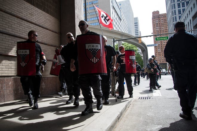 Members of the National Socialist Movement march on Larned Street in Detroit, Saturday, June 8, 2019.