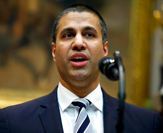 In this April 12, 2019 file photo, Federal Communications Commission Chairman Ajit Pai speaks during an event with President Donald Trump on the deployment of 5G technology in the United States, in the Roosevelt Room of the White House, in Washington. Pai said he plans to recommend the agency approve the $26.5 billion merger of wireless carriers T-Mobile and Sprint.