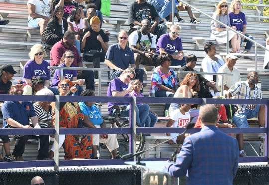 Police Chief James Craig addresses the FCA community block party this month at Southeastern High School football field in Detroit. More than 11,000 Detroit residents have expressed interest in the factory jobs.