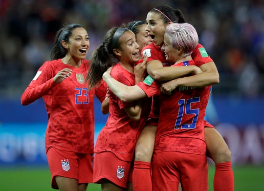 Alex Morgan, second right, celebrates after scoring the United States' 12th goal during the Women's World Cup Group F soccer match against Thailand at the Stade Auguste-Delaune in Reims, France. Morgan scored five goals during the match.