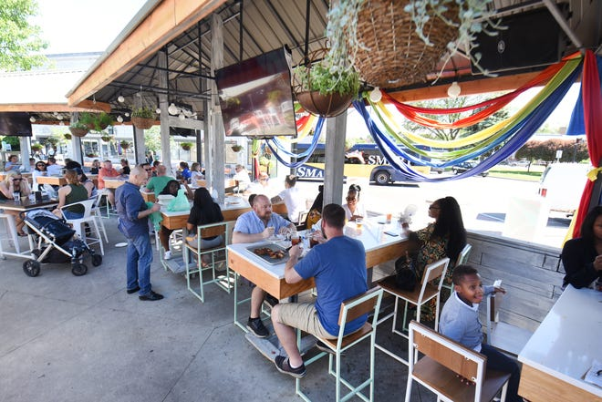 The spacious patio at Como's on Woodward Avenue has beautiful high tables and chairs.